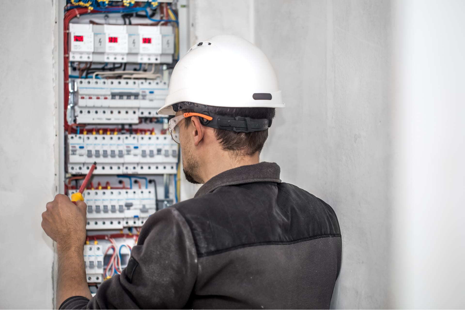 Technician working on an electrical panel